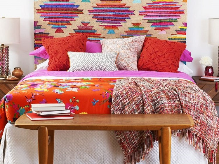 bed with coloured throw pillow